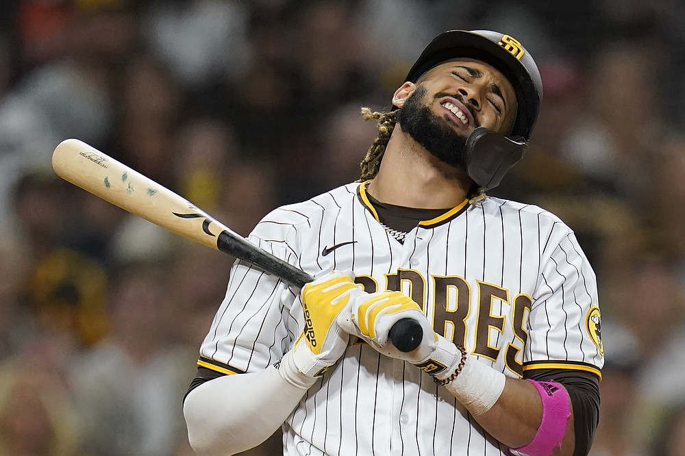 Fernando Tatis Jr. of the San Diego Padres reacts as he hits the bat in the ninth inning of a baseball game against the San Francisco Giants on Tuesday, September 21, 2021, in San Diego.  (AP Photo / Gregory Bull)