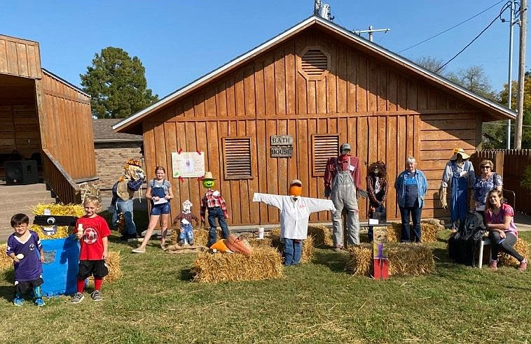 PHOTO BY MELISSA ZIEMIANIN. Photo of youth participants in the 2020 scarecrow contest. The annual contest will be offered again this year with a chalk art contest and decorated pumpkin contest.