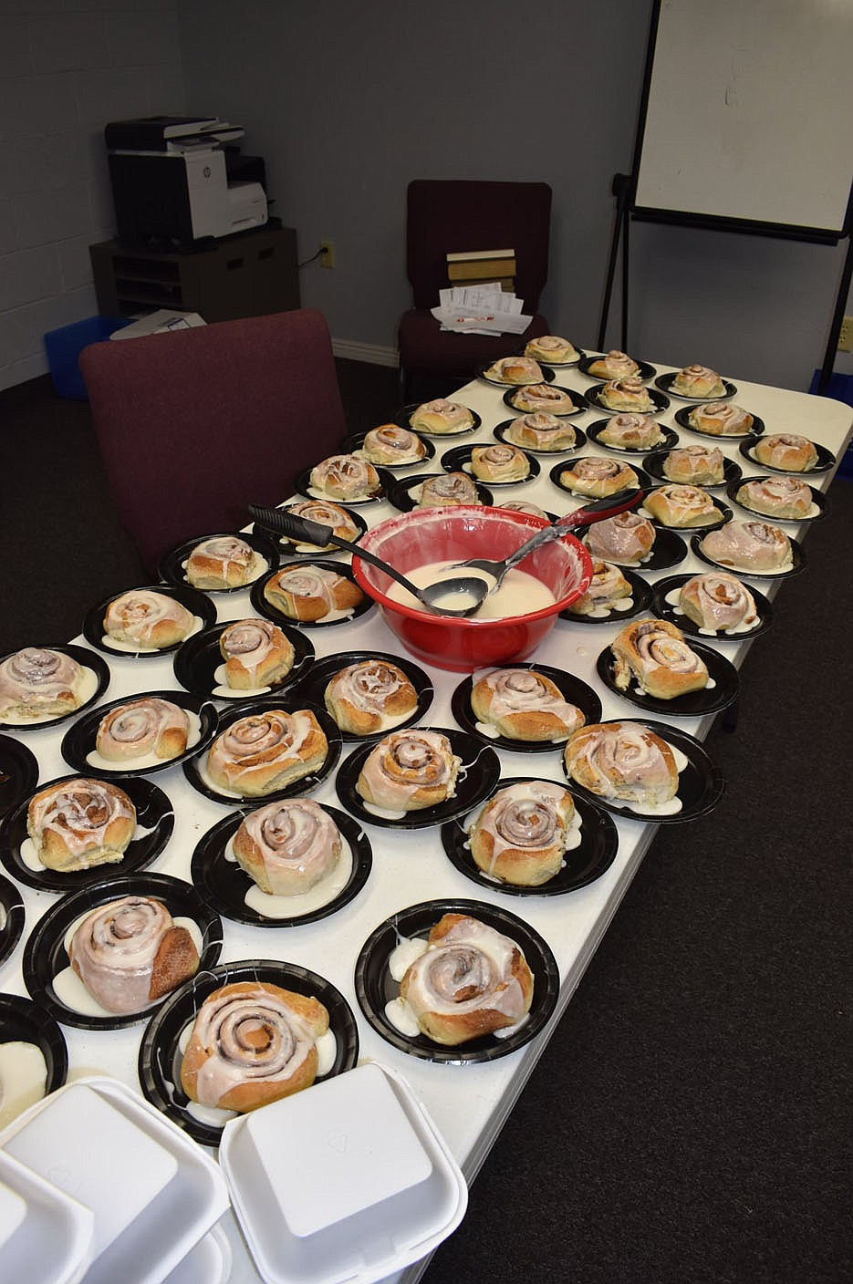 PHOTO BY DALANA FULLER. Photo of homemade cinnamon rolls and icing served at the event. Each event attendee was offered a cinnamon roll to eat or to-go.