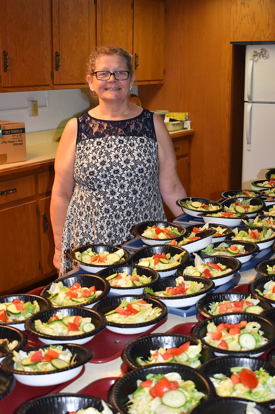 PHOTO BY DALANA FULLER. Photo of PCC volunteer Lynda Dyki. Dyki prepared the salads for the reunion lunch.