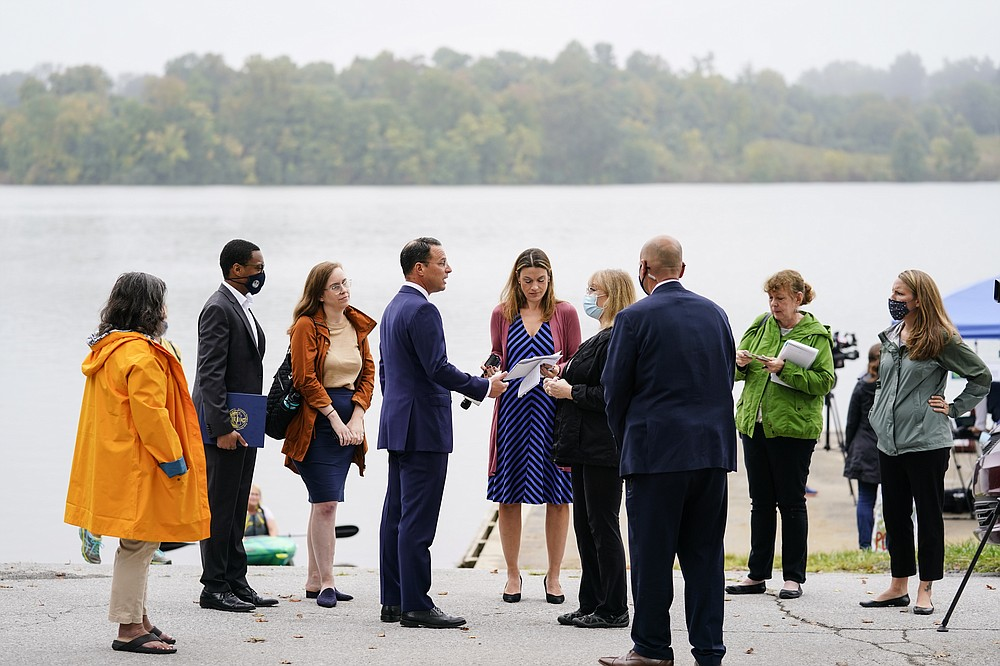 Pennsylvania Attorney General Josh Shapiro, center left, meets with members of the public and the press after a news conference at Marsh Creek State Park in Downingtown, Pa., Tuesday, Oct. 5, 2021. Shapiro filed criminal charges Tuesday against the developer of a problem-plagued pipeline that takes natural gas liquids from the Marcellus Shale gas field to an export terminal near Philadelphia. (AP Photo/Matt Rourke)