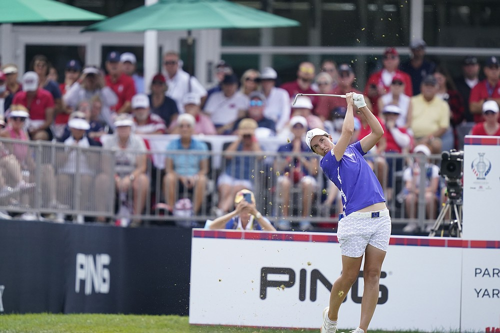 FILE - Europe's Carlota Ciganda drives off the 12th tee during a four-ball match for the Solheim Cup golf tournament in Toledo, Ohio, in this Saturday, Sept. 4, 2021, file photo. Ciganda was the first winner of the Aon Risk-Reward Challenge, which offered equal bonus money of $1 million to men and women. (AP Photo/Carlos Osorio, File)