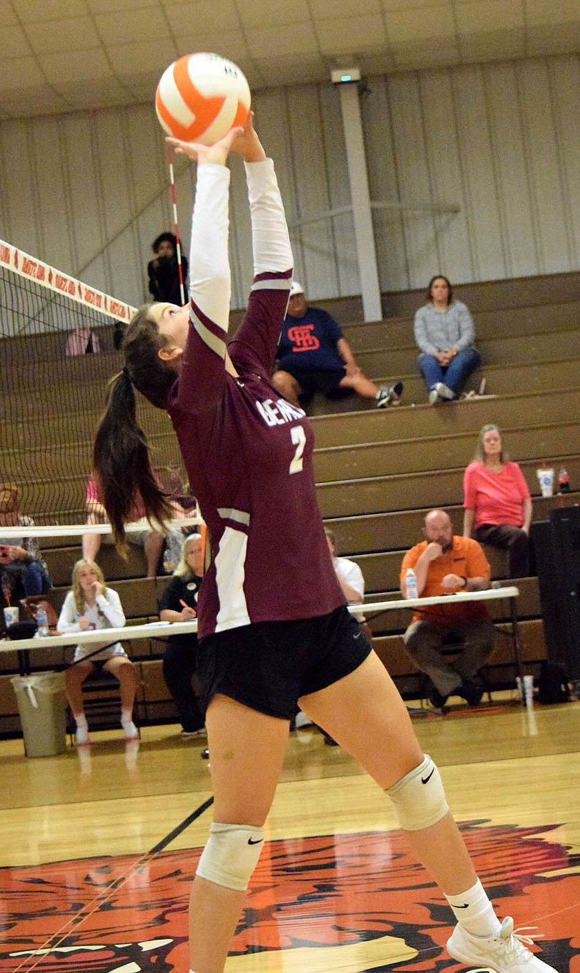 Westside Eagle Observer?MIKE ECKELS Lady Pioneer Reese Hester uses both hands to power the ball back over her head and into the Lady Lion side of the court during the Thursday night Gravette-Gentry varsity volleyball match in Gravette. In its final 2021 appearance in the Competition Gym in Gravette, the Lady Lions claimed the three set victory over the Lady Pioneers.