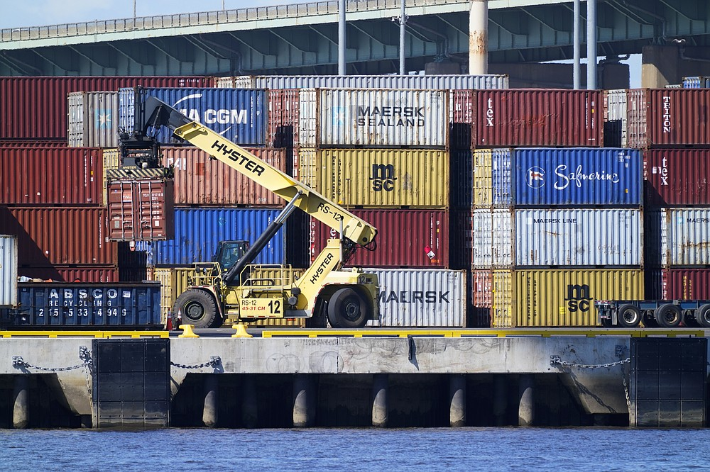 A shipping container is moved along the Delaware River in Philadelphia , Wednesday, Sept. 29, 2021. With three months until Christmas, toy companies are racing to get their toys onto store shelves as they face a severe supply network crunch. Toy makers are feverishly trying to find containers to ship their goods while searching for new alternative routes and ports. (AP Photo/Matt Rourke)
