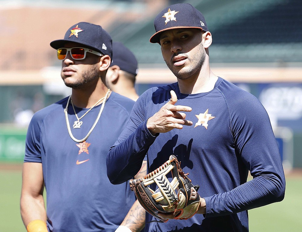 Houston Astros shortstop Carlos Correa, right, and Jose Siri transition between drills during a team workout on Tuesday, Oct. 5, 2021, in Houston. The Astros are preparing for the American League Division Series against the Chicago White Sox. (Kevin M. Cox/The Galveston County Daily News via AP)