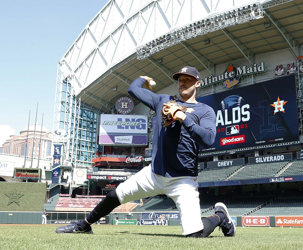 Houston Astros shortstop Carlos Correa runs a drill during a team workout on Tuesday, Oct. 5, 2021, in Houston. The Astros are preparing for the American League Division Series against the Chicago White Sox. (Kevin M. Cox/The Galveston County Daily News via AP)