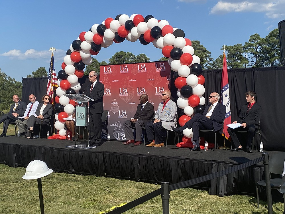 Dr. Donald Bobbitt, president of the University of Arkansas System, speaks to the audience about about the potential impact this new facility could have on the community as a whole.  (Staff photo by Andrew Bell)