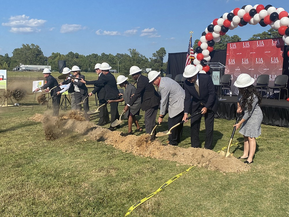 Members of UAHT, the University of Arkansas System and the city of Texarkana join for the ceremonial groundbreaking of UAHT's new $3.85 million facility.  (Staff photo by Andrew Bell)