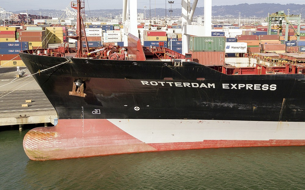 The Rotterdam Express is seen at the Port of Oakland, Wednesday, Oct. 6, 2021 in Oakland, Calif. The Rotterdam Express, a massive cargo ship made a series of unusual movements while anchored in the closest spot to a Southern California oil pipeline that ruptured and sent crude washing up on beaches, according to data collected by a marine navigation service. (AP Photo/Josh Edelson)