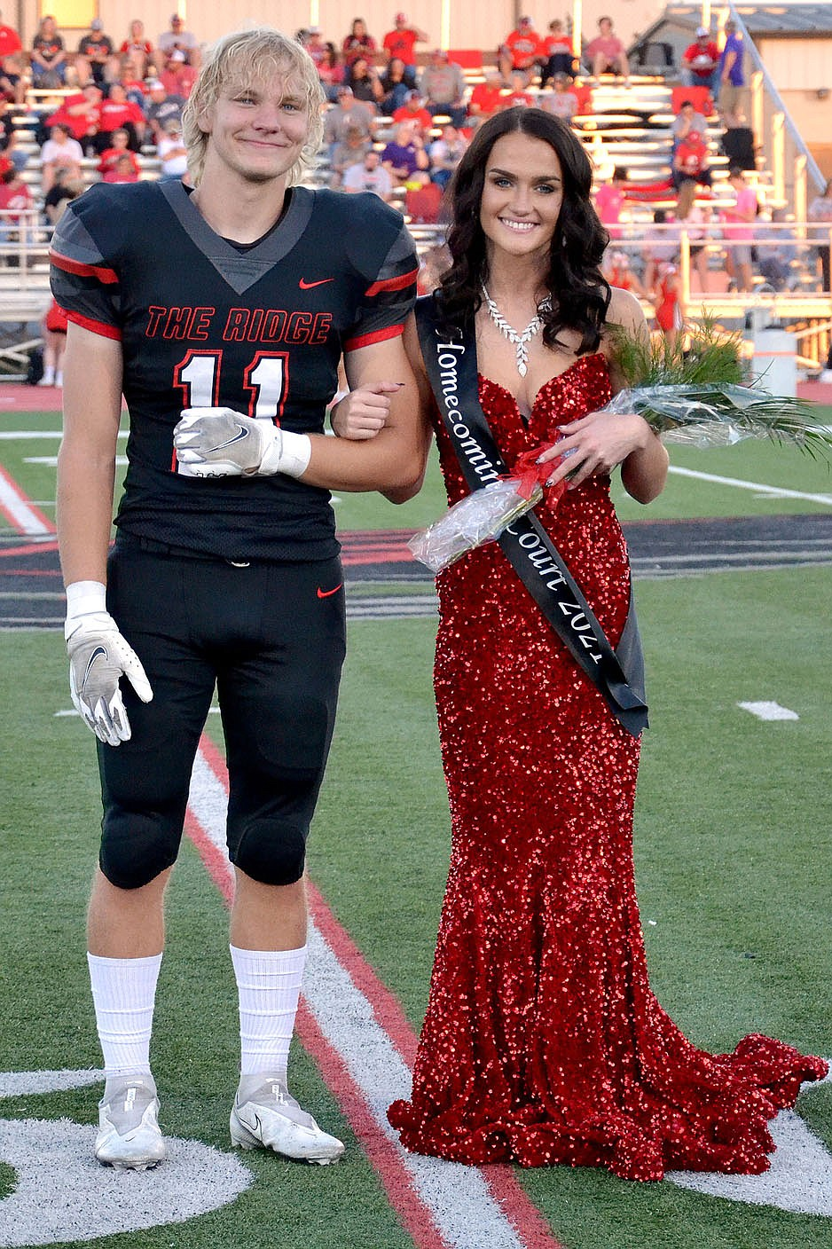 Homecoming maid Paige Brown, 17, daughter of Aimee Yager and Adam Yager, was escorted by Will Anderson.