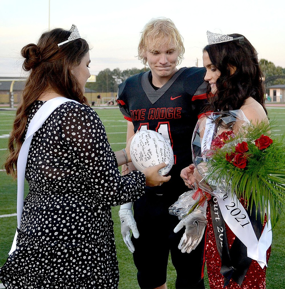 Blackhawk Homecoming Queen 2020 Gracie Easterling presented a signed football to Will Anderson and Paige Brown after she was announced as 2021 Homecoming Queen Friday, Oct. 8, 2021.