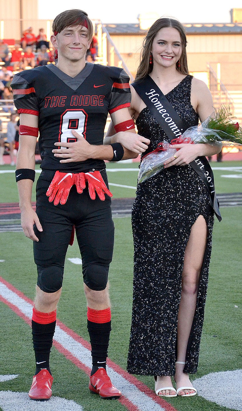 TIMES photograph by Annette Beard Homecoming maid Lauren Wright, 17, daughter of Brian Wright and Katie Burns, was escorted by Trevor Blair.