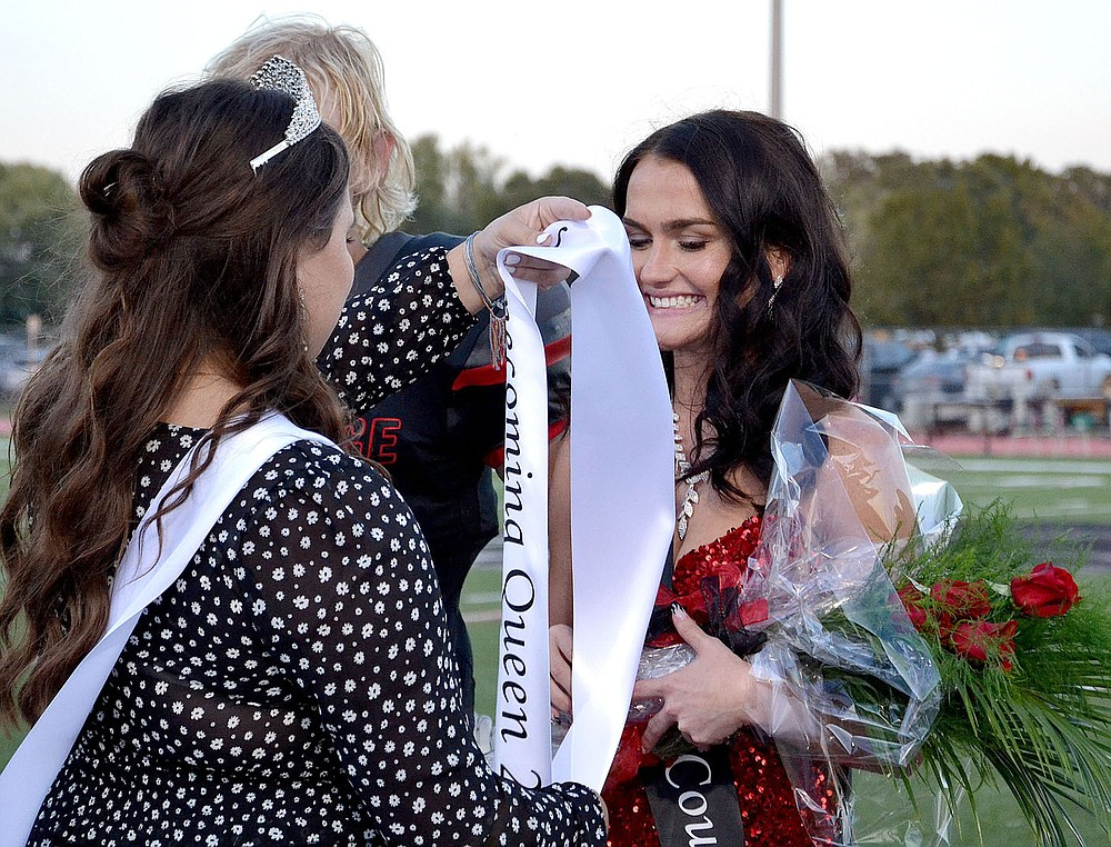 TIMES photograph by Annette Beard Blackhawk Homecoming Queen 2020 Gracie Easterling placed a banner on Paige Brown, 2021 Homecoming Queen, before crowning her Friday night in Blackhawk Stadium.