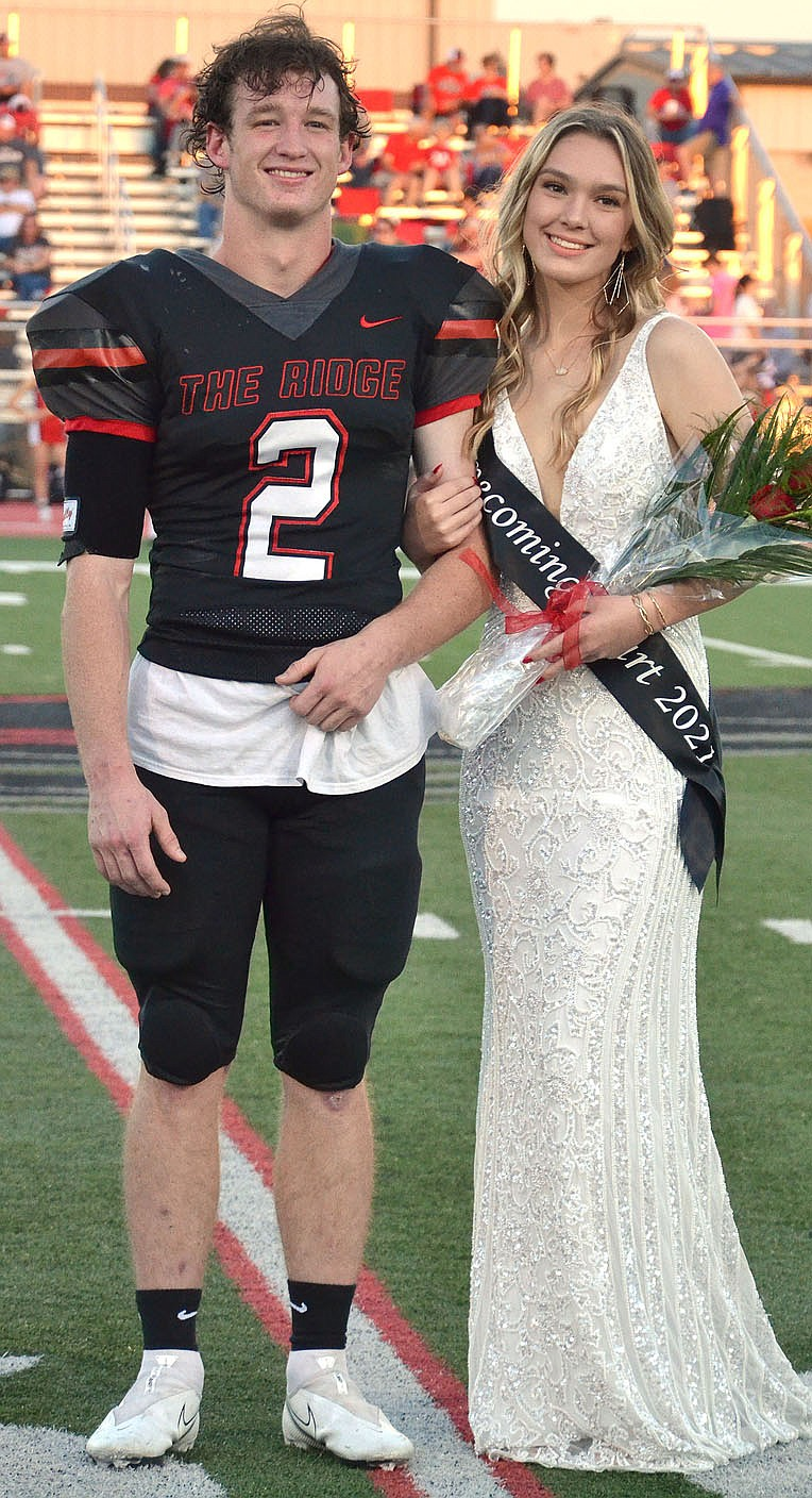 Homecoming maid Lillian Murray, 17, daughter of Steve and Emily Murray, was escorted by Joe Adams.