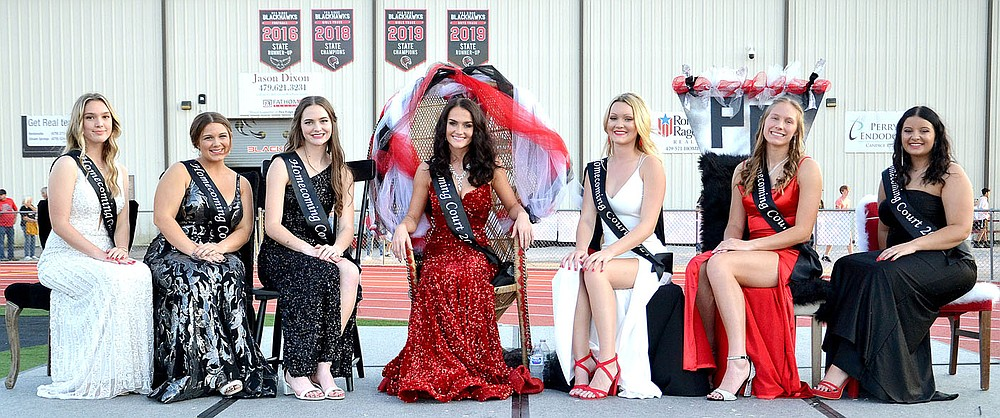 TIMES photograph by Annette Beard The Blackhawk Homecoming maids, from left, Lillian Murray, Nalea Holliday, Lauren Wright, Paige Brown, Gabbie Fletcher, Dallice White and Marie Foltz posed before their presentation to the crowd in Blackhawk Stadium.
