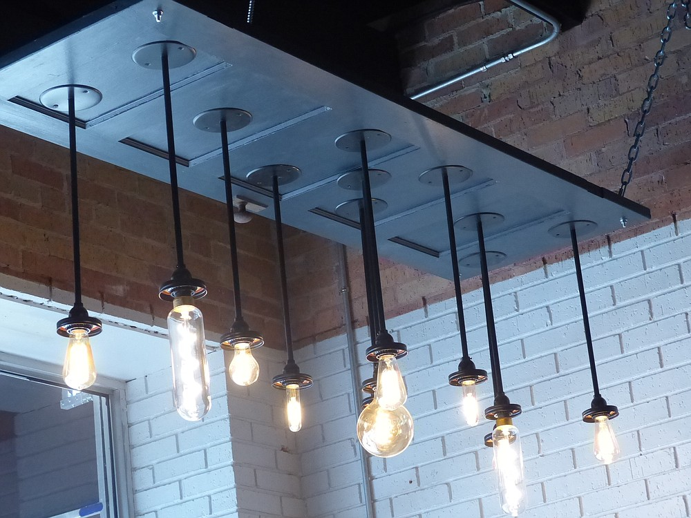 Stop in at the Cafe Crema Coffee Shop in Atlanta on East Main Street and notice the unusual homemade chandelier. It's the creation of owner Greg Beers. Can you tell that it was once simply a wooden door?