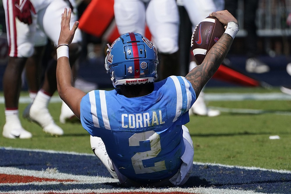 Mississippi quarterback Matt Corral (2) celebrates his seven-yard touchdown run against Arkansas during the first half of an NCAA college football game, Saturday, Oct. 9, 2021, in Oxford, Miss. (AP Photo/Rogelio V. Solis)