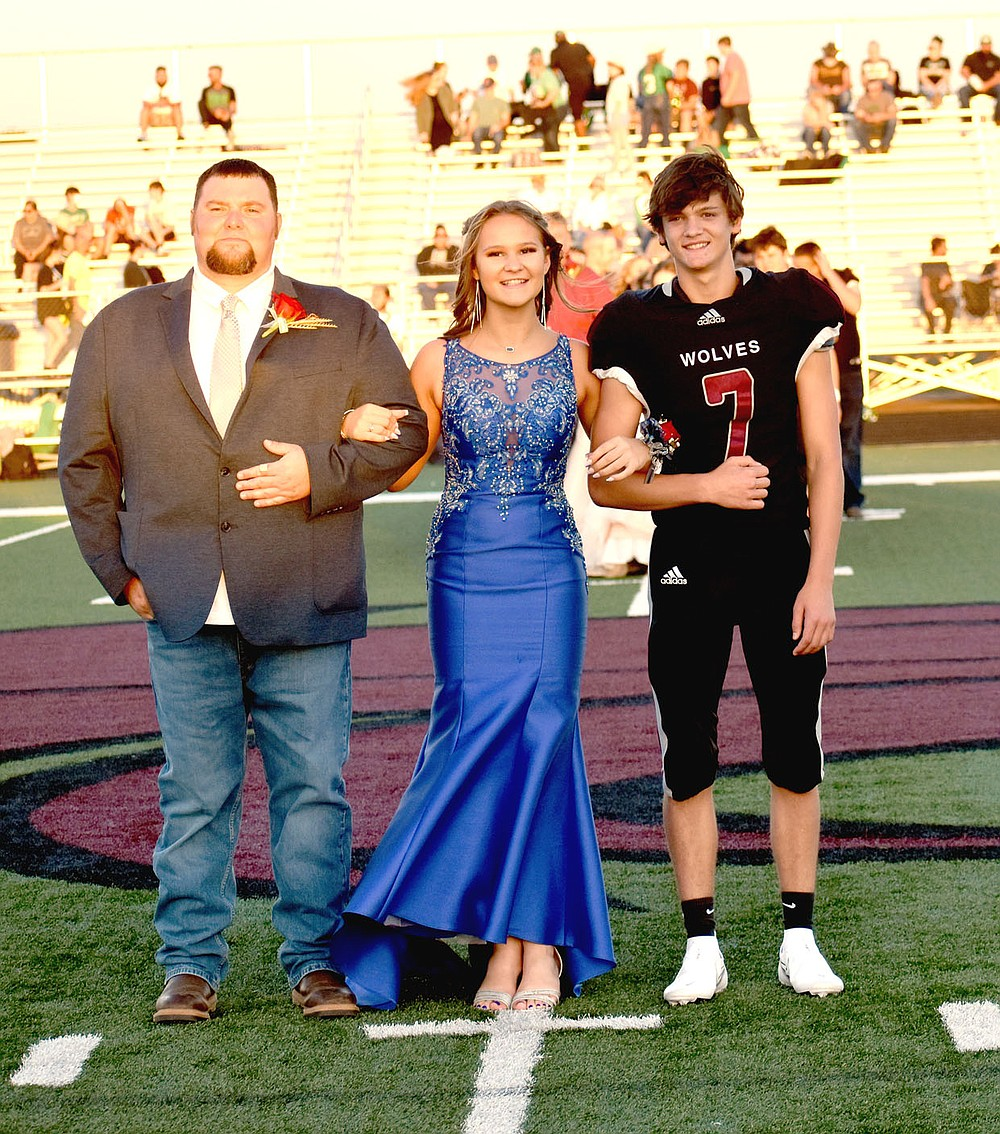MARK HUMPHREY  ENTERPRISE-LEADER/Lincoln sophomore Addie Pershall escorted by Casey Pershall and Trace Wallace.