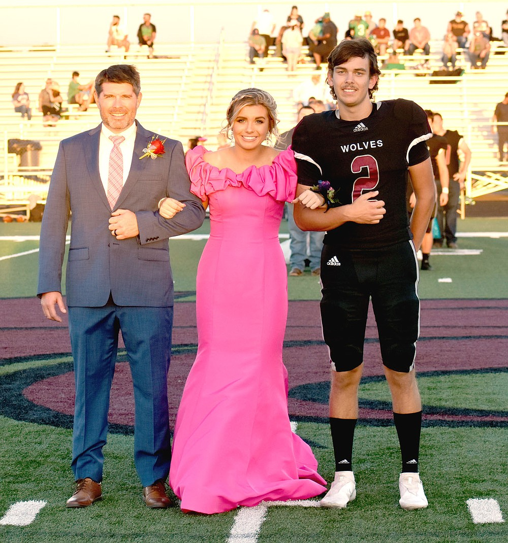 MARK HUMPHREY  ENTERPRISE-LEADER/Lincoln freshman maid Brinkley Moreton, daughter of Dax and Christina Moreton, escorted by her father and sophomore Drew Moore, son of Joshua and Kendra Moore.