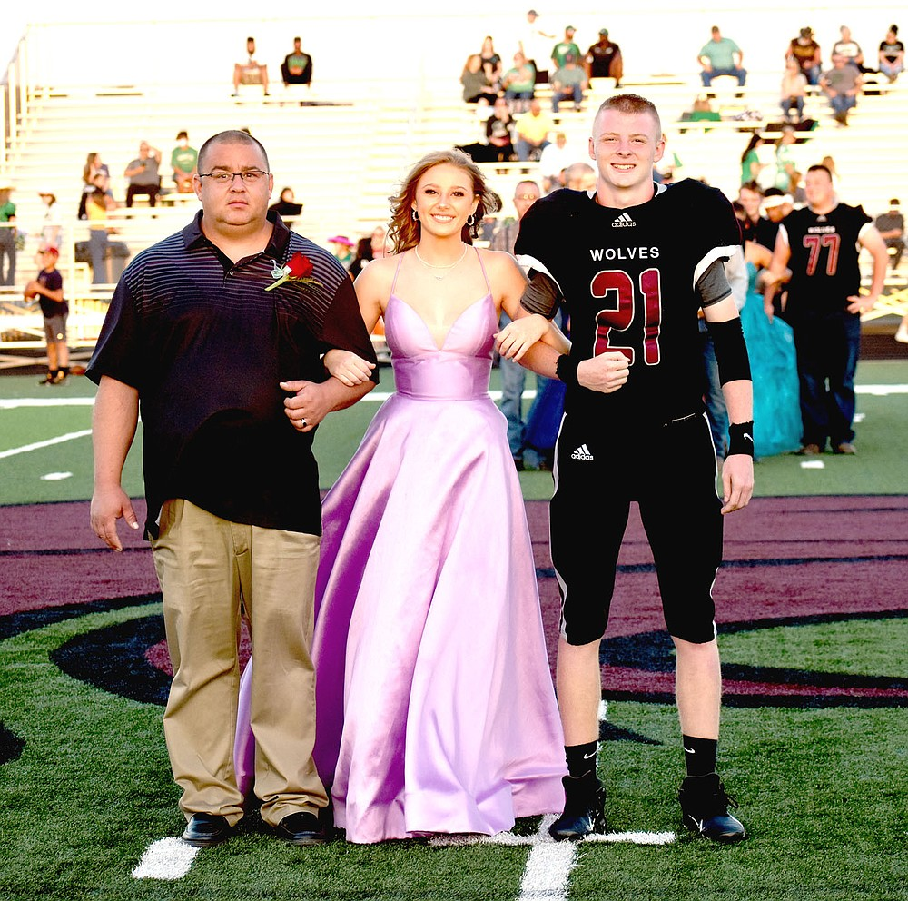 MARK HUMPHREY  ENTERPRISE-LEADER/Lincoln junior maid Kate Hager escorted by her dad and senior Lincoln Morphis, son of Russell Morphis and Mandi Curry.
