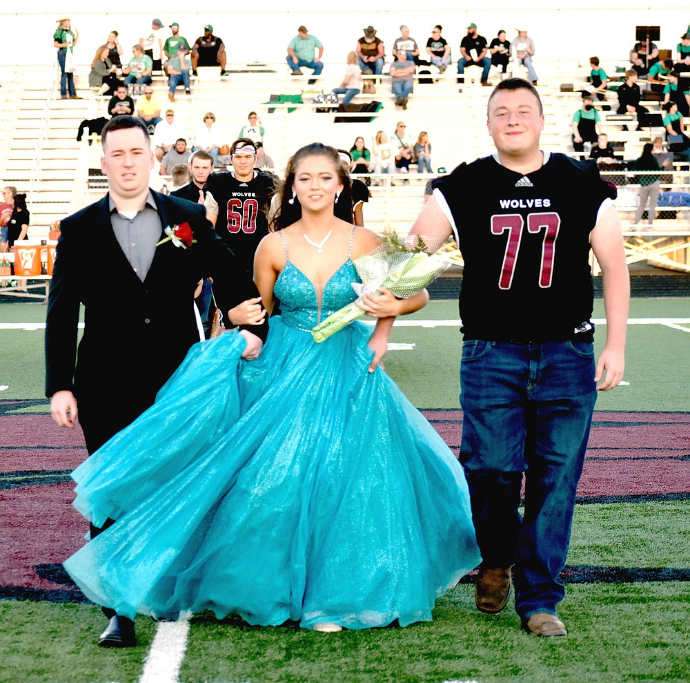 MARK HUMPHREY  ENTERPRISE-LEADER/Lincoln junior Lily Riherd escorted by her brother and Val Diaz.
