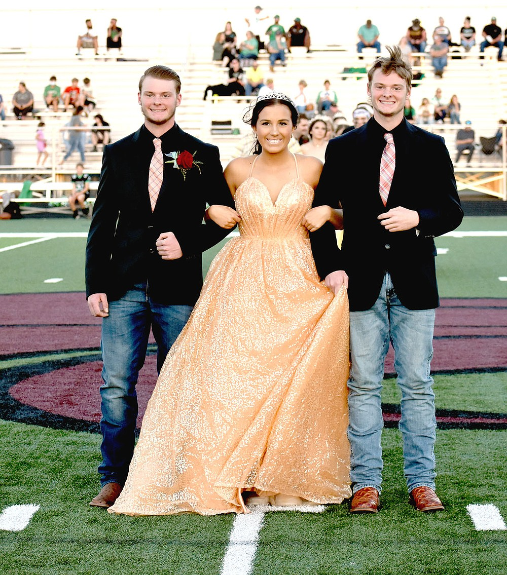 MARK HUMPHREY  ENTERPRISE-LEADER/Lincoln senior Katie Jones escorted by twin brothers, Brodey (left) and Blake Bowen.