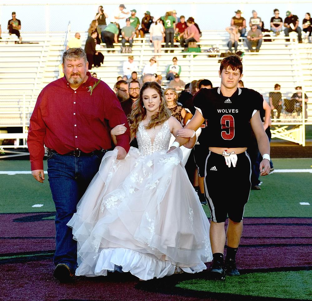 MARK HUMPHREY  ENTERPRISE-LEADER/Lincoln sophomore maid Morgan Reeves escorted by her dad and sophomore Kellar Price.