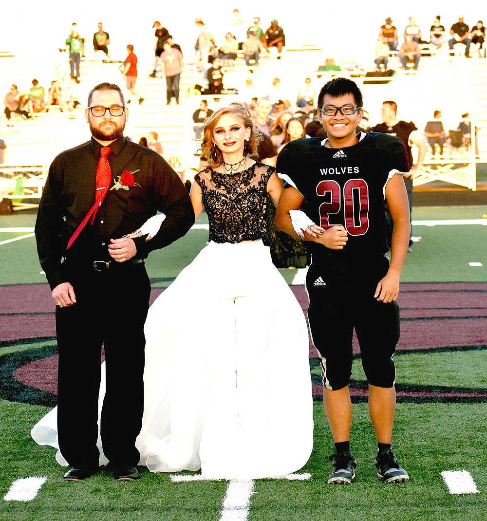 MARK HUMPHREY  ENTERPRISE-LEADER/Lincoln sophomore Symphony Richards escorted by her dad and Nick Moua.