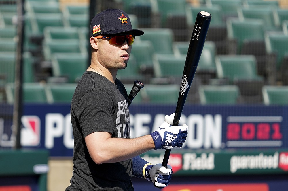 Houston Astros' Aledmys Diaz watches during baseball practice for the American League Division Series, Saturday, Oct. 9, 2021, in Chicago. The Chicago White Sox host the Astros in Game 3 on Sunday. (AP Photo/Nam Y. Huh)