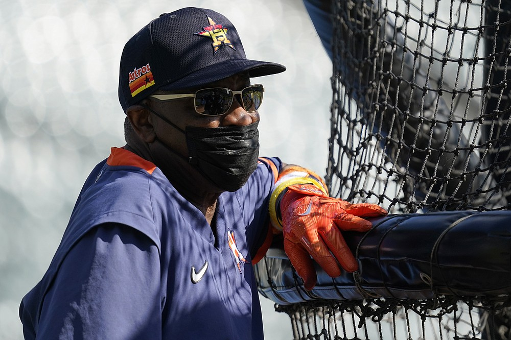 Houston Astros manager Dusty Baker Jr., watches his team during baseball practice for the American League Division Series, Saturday, Oct. 9, 2021, in Chicago. The Chicago White Sox host the Astros in Game 3 on Sunday. (AP Photo/Nam Y. Huh)