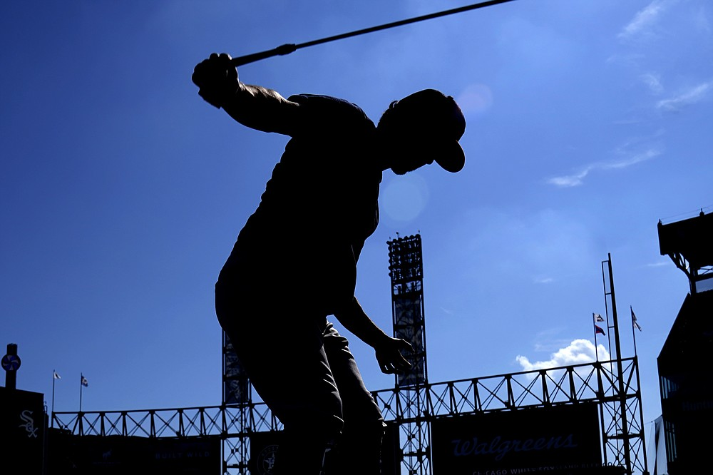 Houston Astros' Garrett Stubbs warms up during baseball practice for the American League Division Series, Saturday, Oct. 9, 2021, in Chicago. The Chicago White Sox host the Astros in Game 3 on Sunday. (AP Photo/Nam Y. Huh)