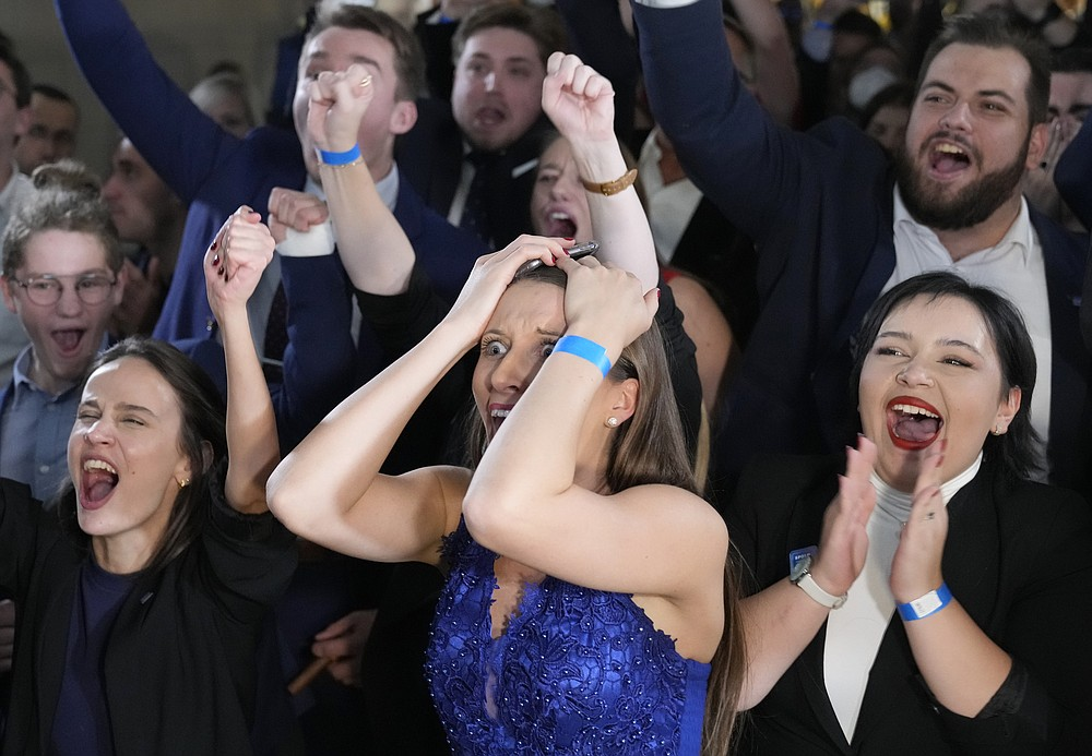 Supporters of leader of center-right Spolu (Together) coalition Petr Fiala react to election results in Prague, Czech Republic, Saturday, Oct. 9, 2021. The center-right Together coalition was capturing 23.9% of the votes while the center-left coalition of the Pirate Party and STAN, a group of mayors and independent candidates, were coming in third with 13.5% support. (AP Photo/Darko Bandic)