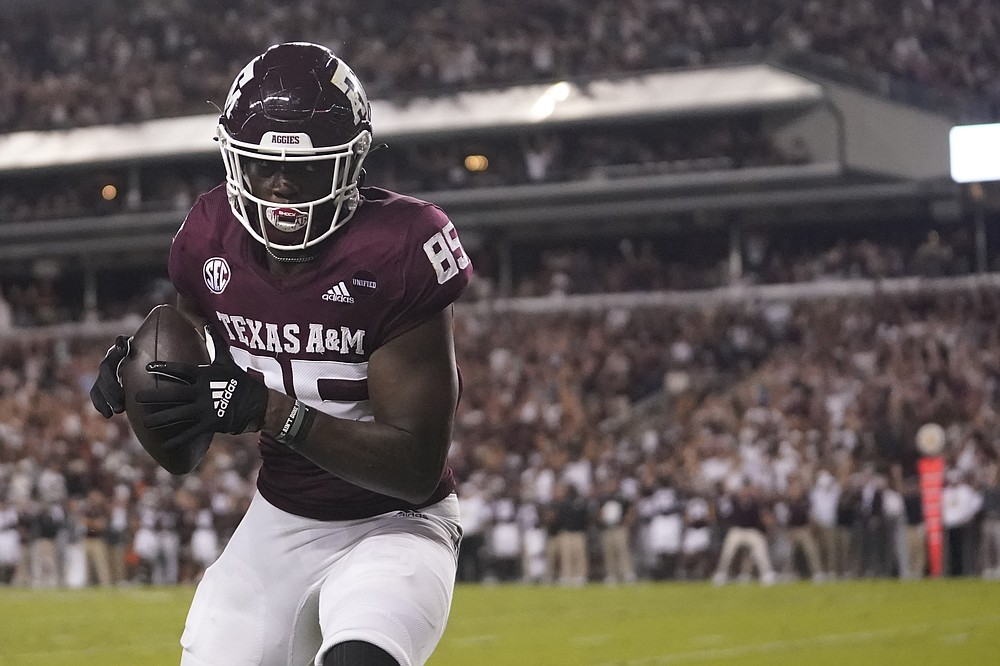 Texas A&M tight end Jalen Wydermyer catches a pass for a touchdown against Alabama during the first half of an NCAA college football game Saturday, Oct. 9, 2021, in College Station, Texas. (AP Photo/Sam Craft)
