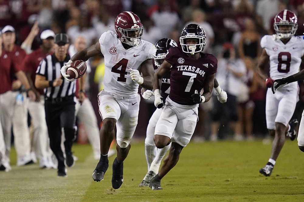Alabama running back Brian Robinson Jr. (4) breaks free for a gain along the sideline against Texas A&M during the first half of an NCAA college football game Saturday, Oct. 9, 2021, in College Station, Texas. (AP Photo/Sam Craft)