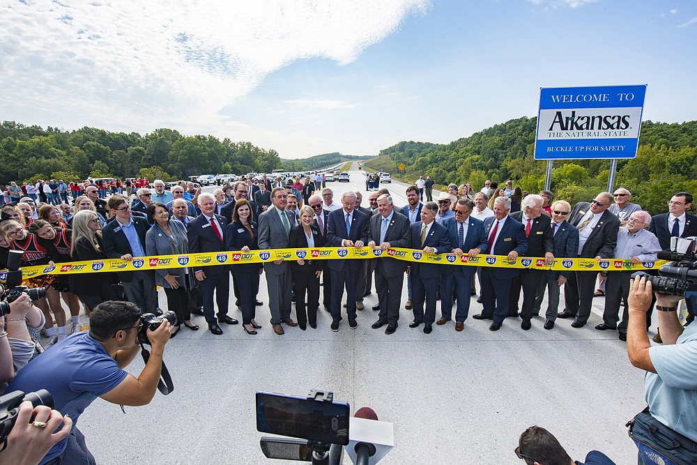 Photo courtesy of the Interstate 49 International Coalition Another piece of the Interstate 49 puzzle fell in place Thursday morning when governors of Arkansas and Missouri, Asa Hutchinson and Mike Parson, respectively, cut the ribbon and opened the $220 million Bella Vista bypass in Northwest Arkansas and the Missouri border.