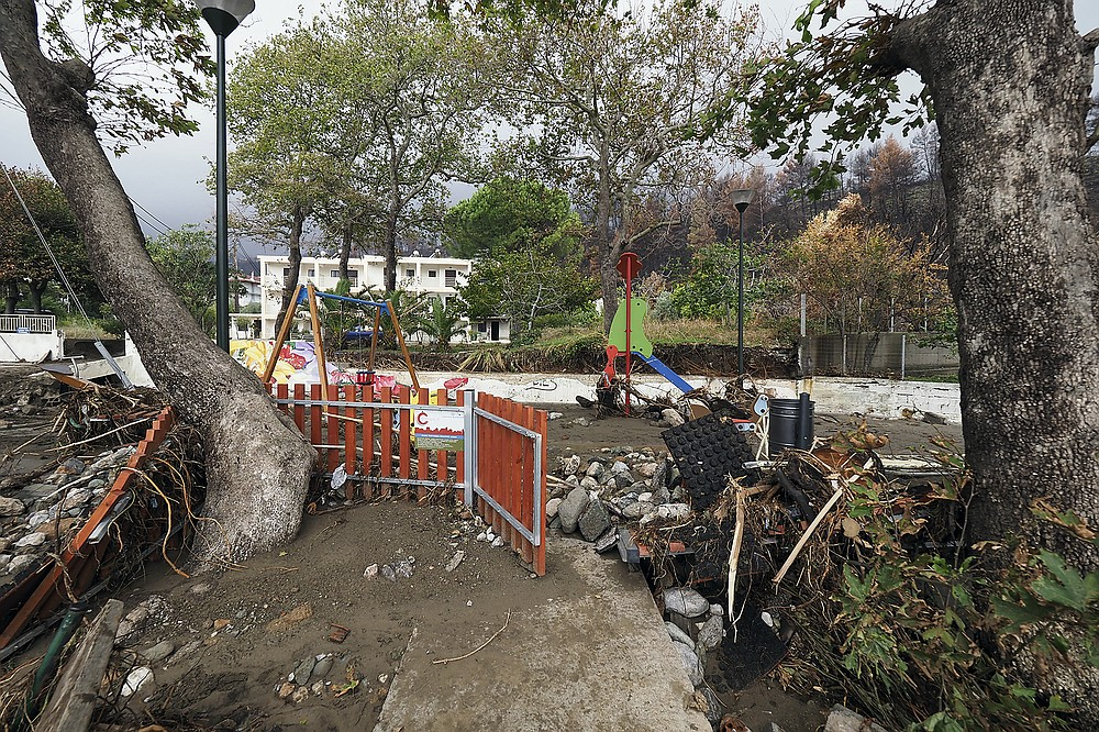 A destroyed playground is pictured at Achladi village following a flood on the northern part of Evia island, Greece, Sunday, Oct. 10, 2021. The wildfires that destroyed a third of the island's forests in early August have loosened the topsoil and several communities are at risk from flooding. (AP Photo/Thodoris Nikolaou)