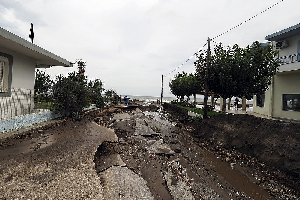 A destroyed road leading to the beach of Agia Anna village, following a flood on the northern part of Evia island, Greece, Sunday, Oct. 10, 2021. The wildfires that destroyed a third of the island's forests in early August have loosened the topsoil and several communities are at risk from flooding. (AP Photo/Thodoris Nikolaou)
