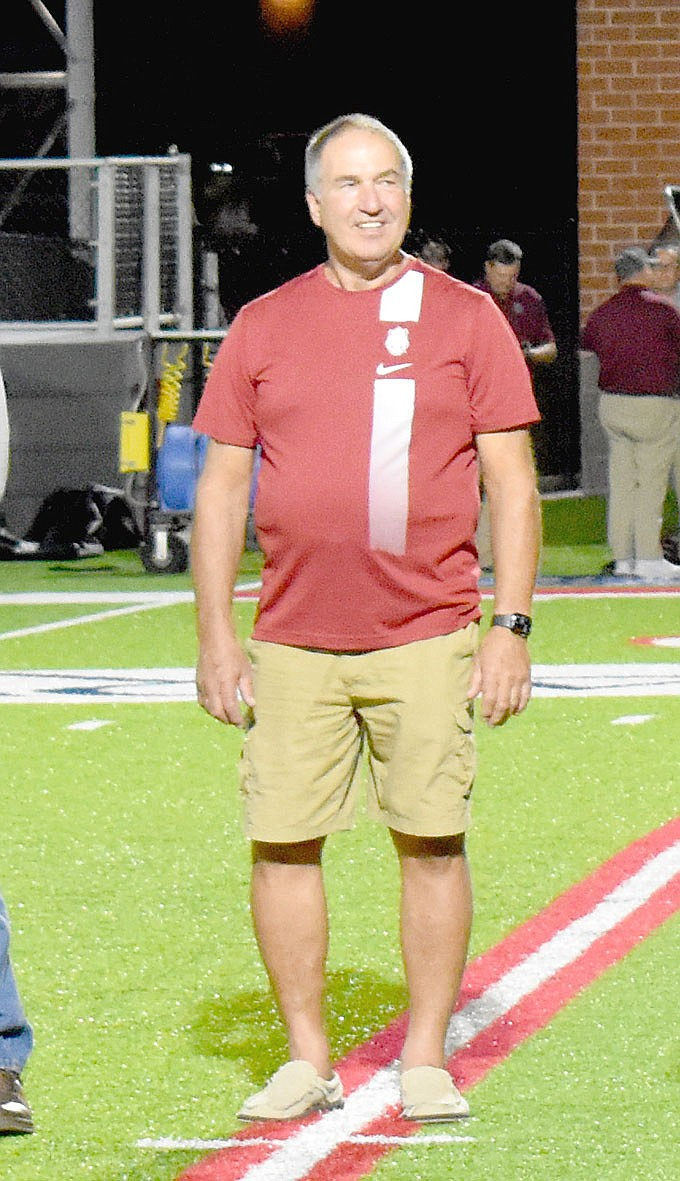 MARK HUMPHREY  ENTERPRISE-LEADER/Keith Marrs wore No. 72 earning All-State, All-District and Most Valuable Defensive Lineman honors as a member of the 1972-1973 Farmington Class B State football championship teams recognized Friday at halftime during the Cardinal football game.