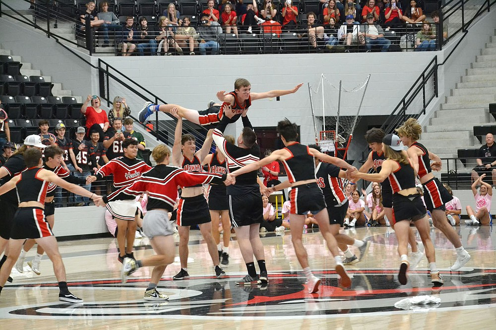 """TIMES photograph by Annette Beard Pea Ridge boys donned cheerleader outfits, cheered, danced, created a pyramid and spun around """"Pickle"""" (Nikolas Galbraith) to cheer and entertain their peers during half-time of the Powder Puff flag football game Friday, Oct. 8, 2021, for Homecoming."""