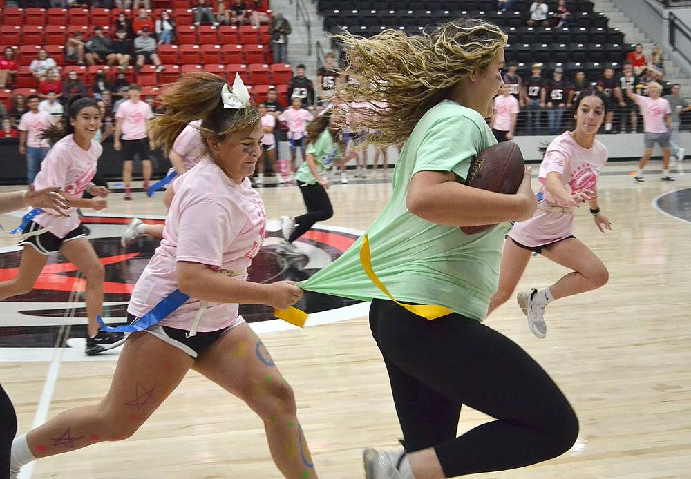 Powder Puff flag football was senior girls against junior girls Friday morning in Blackhawk gym.