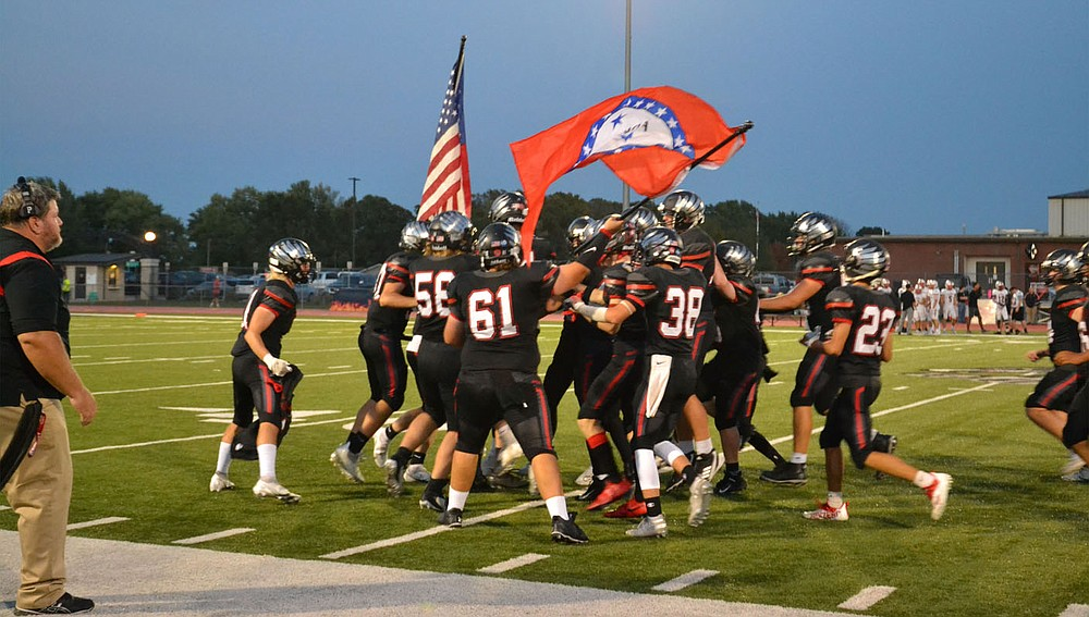 Blackhawks enthusiastically waved the flags immediately after running onto the field Friday, Oct. 8, for the homecoming game against the Vilonia Eagles, who won the contest 35-0.