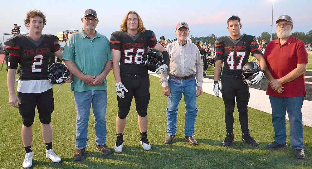 TIMES photograph by Annette Beard Blackhawk football captains and honorary captains for the Homecoming football game Friday, Oct. 8, were Joe Adams, No. 2, Steve Patton, Clay Sebree, No. 58, Doug McKinney, Clayton Henson, No. 47, and J.C. Beaver. The honorary captains were members of the first Blackhawk football team in 1963.