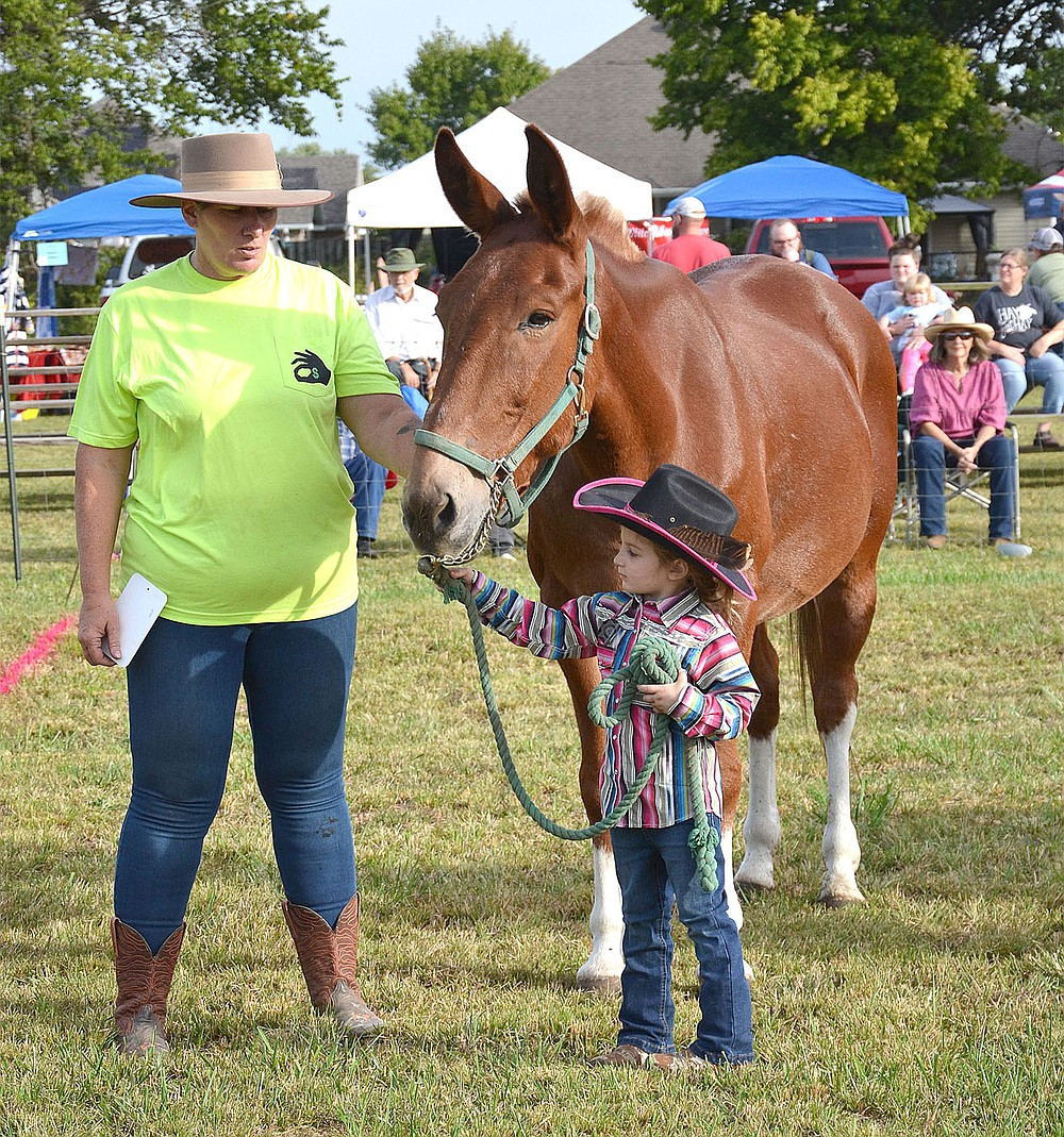 Cyndi Nelson and one of the youngest competitors waited for their turn to be judged in the halter judging.