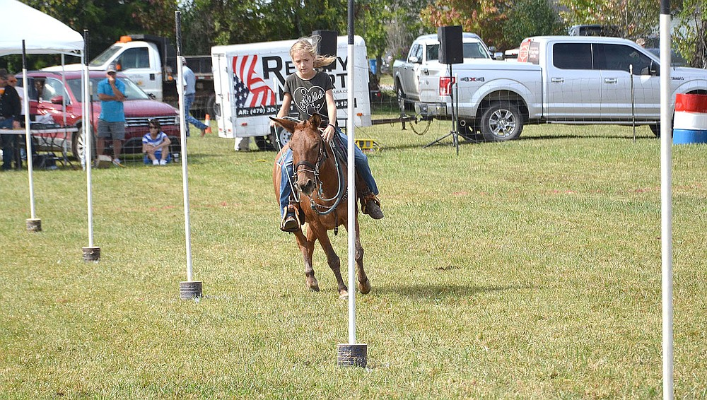 Pole bending is one of the many speed events for competitors at the mule jump.