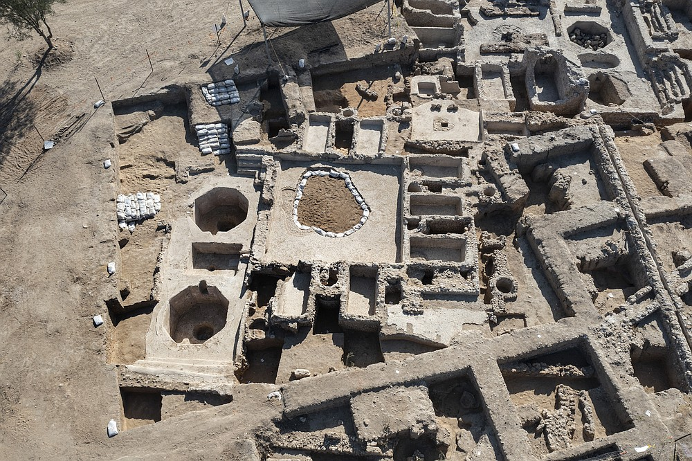 An aerial picture taken by a drone shows a massive ancient winemaking complex dating back some 1,500 years in Yavne, south of Tel Aviv, Israel, Monday, Oct. 11, 2021. Israeli archaeologists said the complex includes five wine presses, warehouses, kilns for producing clay storage vessels and tens of thousands of fragments and jars. (AP Photo/Tsafrir Abayov)