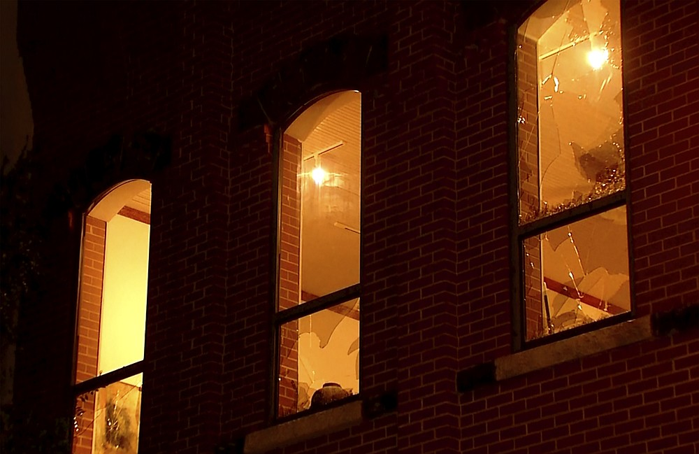 In this image made from video, broken widows from tornadoes are seen on a building late Sunday, Oct. 10, 2021, in Norman, Oklahoma. Several reported tornadoes ripped through Oklahoma late Sunday into early Monday morning, causing damage but no immediate word of deaths or injuries. (KWTV via AP)