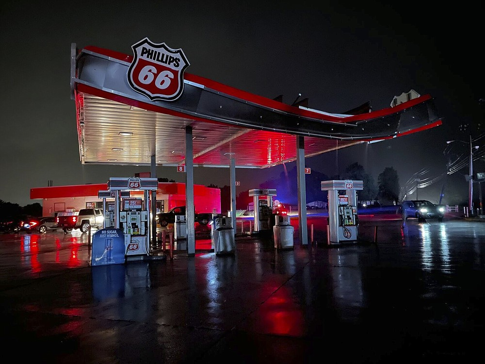 Many spots in Coweta, Okla. took a direct hit from a storm, including a Phillips 66 gas station, Sunday, Oct. 10, 2021. Several reported tornadoes have ripped through Oklahoma, causing damage late Sunday into early Monday morning. (Justin Ayer/Tulsa World via AP)
