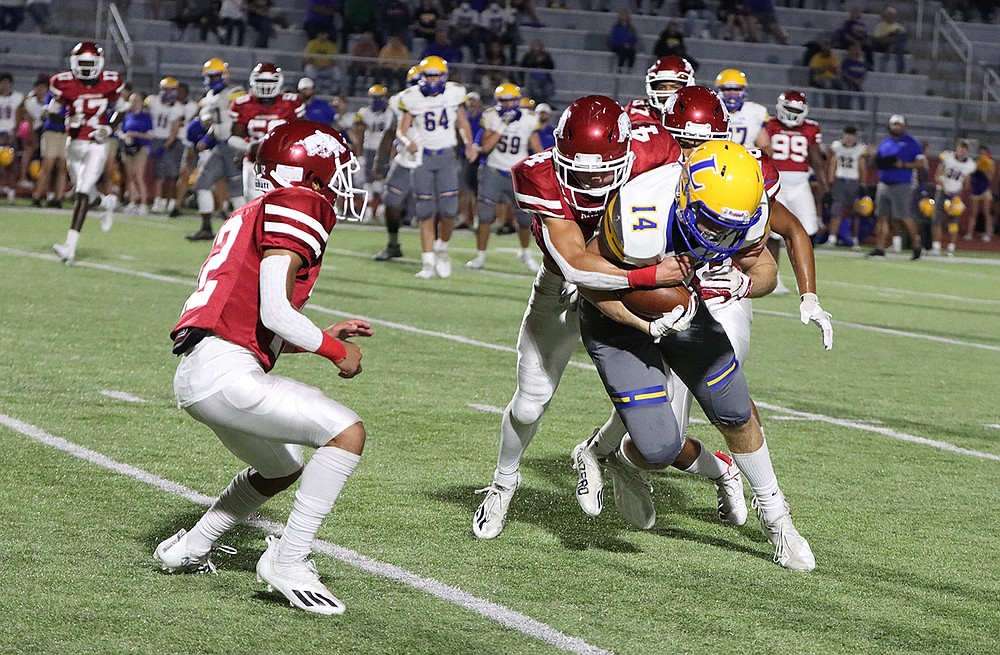 Arkansas High's Logan Williams attempts to bring down Lakeside's Skylar Purifoy during Friday's game at Razorback Stadium in Texarkana. (Photo by Melanie Allen)