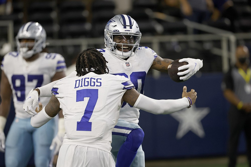 Dallas Cowboys cornerback Trevon Diggs (7) and cornerback Anthony Brown, rear, celebrate after Brown intercepted a New York Giants' Mike Glennon pass and returned it for a touchdown in the second half of an NFL football game in Arlington, Texas, Sunday, Oct. 10, 2021. (AP Photo/Ron Jenkins)
