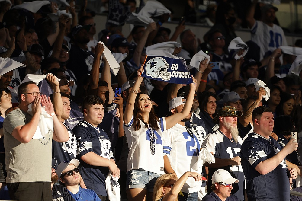 Fans cheer late in the second half of an NFL football game between the New York Giants and Dallas Cowboys in Arlington, Texas, Sunday, Oct. 10, 2021. (AP Photo/Michael Ainsworth)